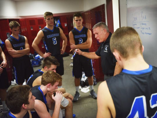 Sioux Falls Christian coach Mike Schouten talks to the team in the locker room at half time during the game against Madison Friday, Jan. 19, at Madison.