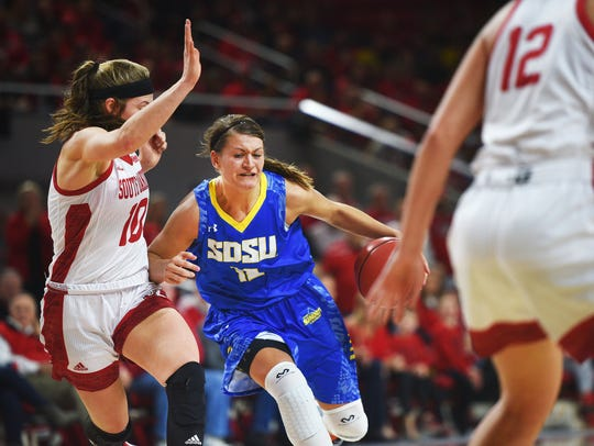 SDSU's Macy Miller runs past USD's Allison Arens during