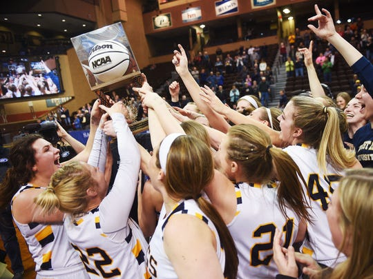 Augustana's women's basketball team celebrates its NSIC championship in 2018 at the Sanford Pentagon in Sioux Falls.