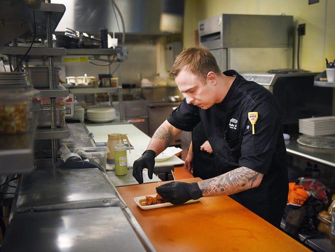 Minervas' sous chef Bradley Herr makes coconut shrimp
