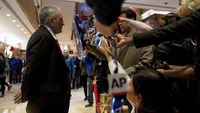 Carl Paladino speaks to members of the media at Trump Tower earlier this month. The former Republican candidate for New York governor caused controversy this week with racist humor about President Barack Obama and first lady Michelle Obama.