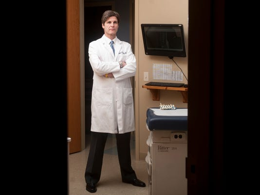 Dr. Laurence Fitzhenry