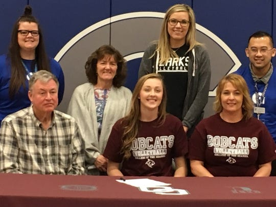 Galena High School standout Megan Caulfield signed a letter of intent to play for the College of the Ozarks Lady Bobcats volleyball team on Tuesday, Feb. 27, 2018 at Galena High in Galena, Missouri. Also present is Megan's mother, Donna (front, right), her father, Steve (front, left), and (back from left) Galena assistant volleyball coach Brooke Villa, Galena head volleyball coach Becky Justis, College of the Ozarks coach Stacy Muckenthaler and Galena High School assistant volleyball coach Ryan Lacson.