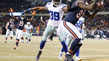 CHICAGO, IL - DECEMBER 4: Martellus Bennett #83 of the Chicago Bears scores a touchdown over Brandon Carr #39 of the Dallas Cowboys during the second quarter of a game at Soldier Field on December 4, 2014 in Chicago, Illinois. (Photo by Joe Robbins/Getty Images)