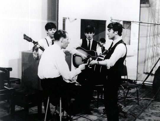 Producer Sir George Martin in the studio with the Beatles.