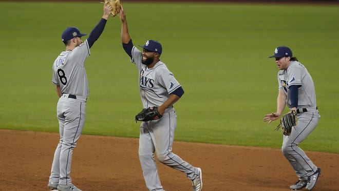 The Tampa Bay Rays celebrate their win against the Los Angeles Dodgers in Game 2 of the baseball World Series Wednesday, Oct. 21, 2020, in Arlington, Texas. Ray beat the Dodgers 6-4.