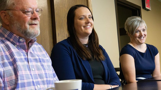 From left, Bryon Schlosser, Amanda Lewis and Michelle Lewis talk about the transition in ownership of Coldwell Banker American Home in Topeka. Mother-daughter duo Michelle and Amanda are the new owners of the company.