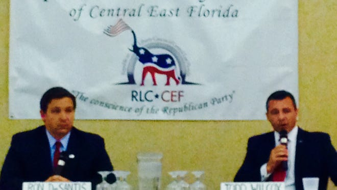 U.S. Senate candidates Ron DeSantis, left, and Todd Wilcox give their views on the issues during a forum Sunday in Viera.