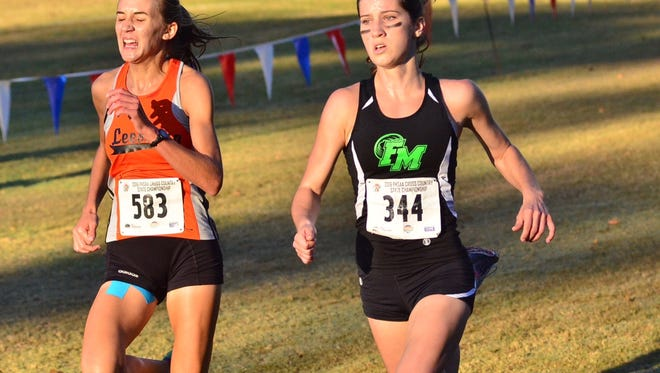 Fort Myers' Krissy Gear, right, run the course at the Class 3A state cross country meet Saturday, Nov. 5, in Tallahassee.