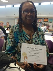 Tonya Howell shows off her Civilian Citation for helping to save a life.