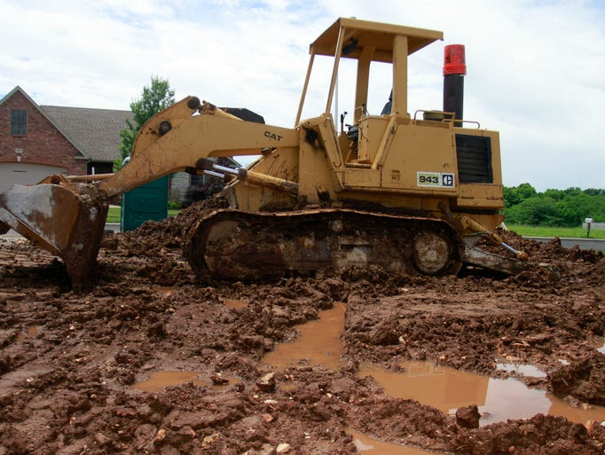 Mud from heavy rains has made it nearly impossible to operate heavy equipment at a construction site North of Springfield on Tuesday, June 10, 2014.