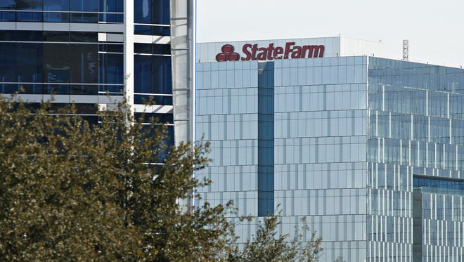 Work continues at the new regional headquarters for State Farm about to open at the new Marina Heights complex on the shore of Tempe Town lake on December 8, 2015.