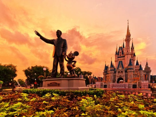 A statue of Walt Disney and Mickey Mouse at Disney World