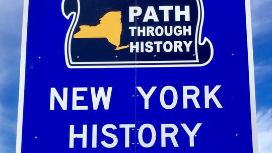 A series of signs touting various New York state programs