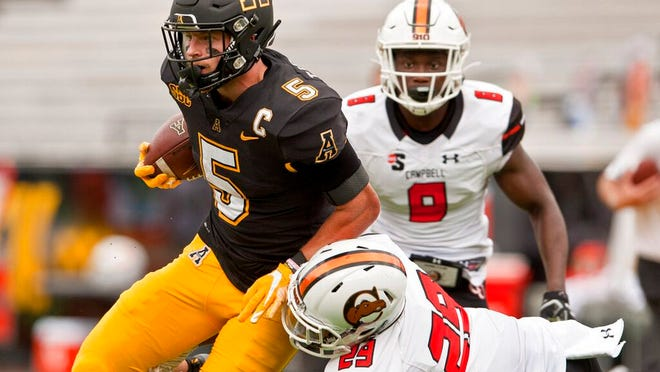 Appalachian St. wide receiver Thomas Hennigan is taken down by Campbell's Levi Wiggins during the second half of an NCAA college football game, Saturday, Sept. 26, 2020 at Kidd Brewer Stadium in Boone, N.C.