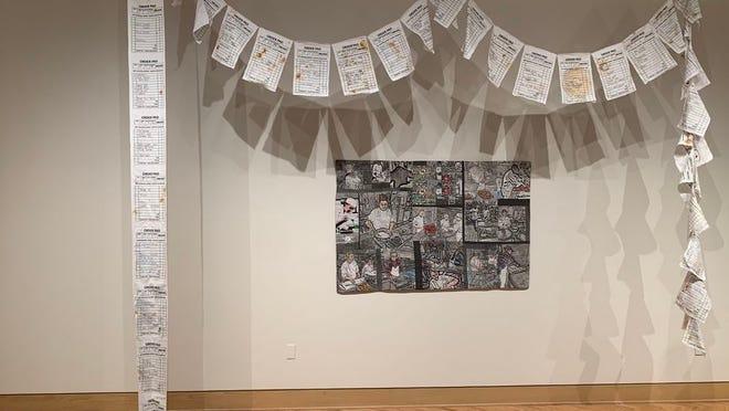 "Susan Callahan's ""Kitchen Prayer Flag,"" 2019 (cotton, acrylic paint, mustard and ketchup, jelly and balsamic dressing, 11.5"" x 20"" x 240"")."