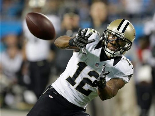 New Orleans Saints wide receiver Marques Colston (12) prepares to catch the ball against the Carolina Panthers in the second half of an NFL football game in Charlotte, N.C., Thursday, Oct. 30, 2014. (AP Photo/Bob Leverone)