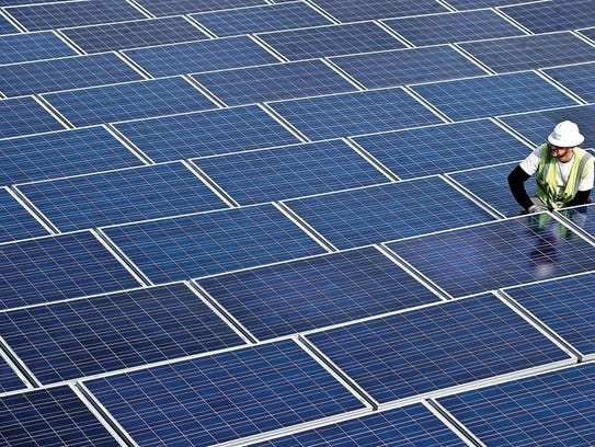In this January 2011 photo, solar panels are placed