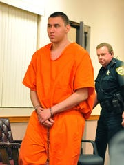 Tyler Hadley (left) is escorted into the courtroom