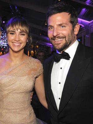 Bradley Cooper and Suki Waterhouse were all smiles at the 2014 Vanity Fair Oscar bash.