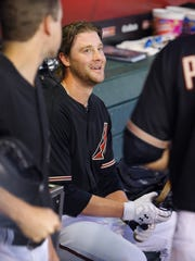 Arizona Diamondbacks starting pitcher Archie Bradley (25) smiles in the dugout during the 6th inning against the Los Angeles Dodgers  in their MLB game  Saturday, April 11, 2015 in Phoenix, Ariz.