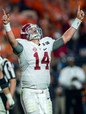 Alabama quarterback Jake Coker (14) celebrates following the Alabama's final touchdown against Clemson in the College Football Playoff Championship Game on Monday January 11, 2016 at University of Phoenix Stadium in Glendale, Az. Alabama won the National Championship.