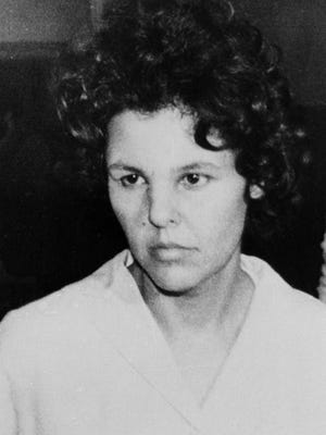 "In this Oct. 21, 1981, file photo, Judith Clark is taken into police custody in Nanuet. Clark, a former radical who drove a getaway car during the 1981 Brinks armored car robbery, will be eligible for parole in 2017 following a commutation from Gov. Andrew Cuomo on Friday. On Monday, Cuomo said Clark impressed him as ""community-oriented"" when they met and that he believes the former radical should be able to make her case for freedom."