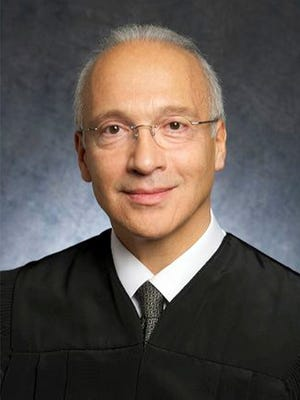 FILE - This undated photo provided by the U.S. District Court shows Judge Gonzalo Curiel. Curiel, who was taunted by Donald Trump during the presidential campaign, has sided with the president on a challenge to building a border wall with Mexico. Curiel on Tuesday, Feb. 27, 2018 rejected arguments by the state of California and advocacy groups that the administration overreached by waiving laws requiring environmental and other reviews before construction could begin.