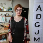 Jessica Krcmarik, 25, of Detroit works in her studio on typefaces she designs from vintage Detroit signs for her company, Gratiot and Riopelle, on Wednesday, Oct. 7, 2015.