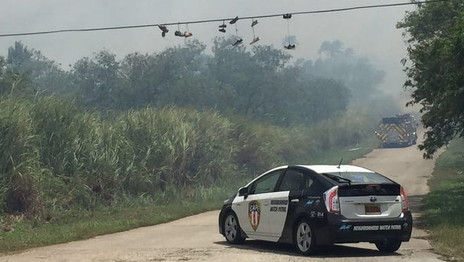 Navy and Guam fire department units battle a grass fire in the Nimitz Hill valley.