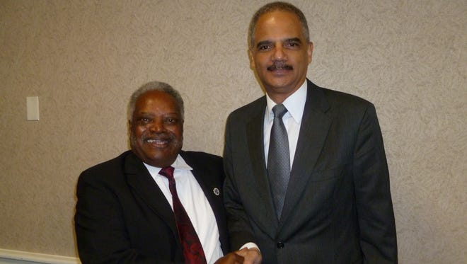 Rev. Tex Thomas, left, and former U.S. Attorney General Eric Holder.