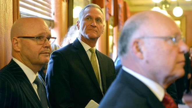 South Dakota Gov. Dennis Daugaard waits in the hall moments before being introduced for his state of the state address Tuesday, Jan. 10, 2017, in Pierre, S.D.