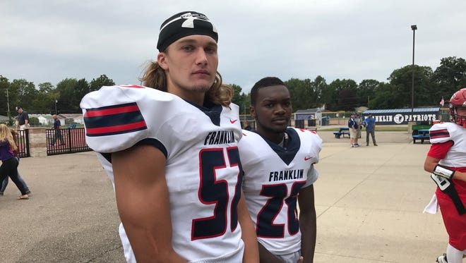 Livonia Franklin seniors Jacob Mass (52) and Keion Harris (26) are pumped up to lead the Patriots back to the playoffs.