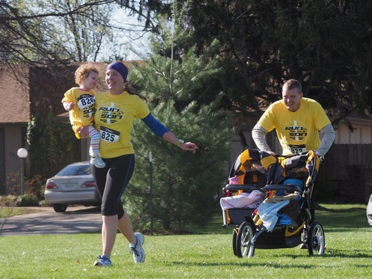 Jessica and Joshua Barrows Sr. took advantage of the spring weather to run with their children, Eleanor and Josh Jr., last year at the Run for the Son.