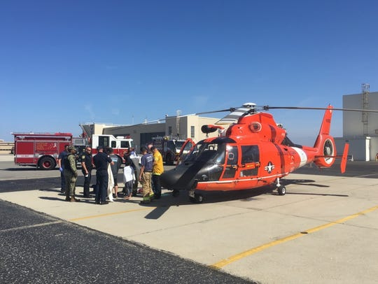 Coast Guard helicopter and boat crews rescued six people from a sinking vessel 12 miles south of Channel Islands Harbor on June 10.