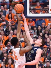 Mar 4, 2017; Syracuse, NY, USA; Georgia Tech Yellow Jackets center Ben Lammers (44) gets a finger on the shot of Syracuse Orange forward Taurean Thompson (12) to make a block during the first half of a game at the Carrier Dome. Mandatory Credit: Mark Konezny-USA TODAY Sports