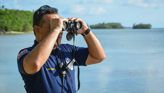 Guam Fire Department Capt. Ronnie Chiguina searches for a 51 year-old man who was reported missing in Agat on June 9. 