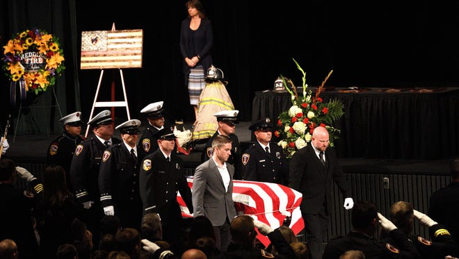 The casket of Jeremy Stoke enters the Redding Civic Auditorium on Saturday for his memorial service.