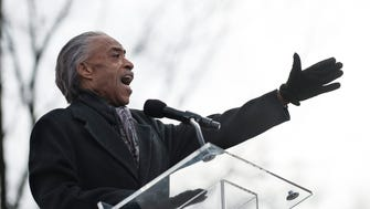 The Rev. Al Sharpton addresses families and supporters of several African Americans recently killed in confrontations with police at a rally in Washington, D.C., on Dec. 13, 2014.