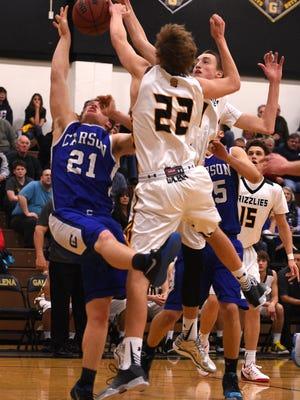 Galena's Derek Kline (22) blocks the shot of Carson's Jace Keema (21) during their basketball game in Reno on Friday.