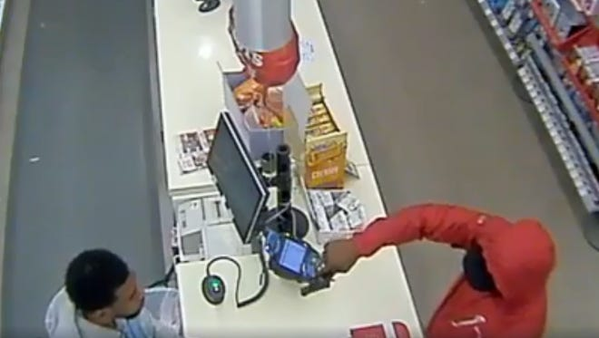 Robber attempts to hold-up Walgreens clerk.