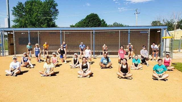 Members of the Perry softball team pose for a photo while practicing social distancing. PHOTO COURTESY OF TINA LUTTERMAN