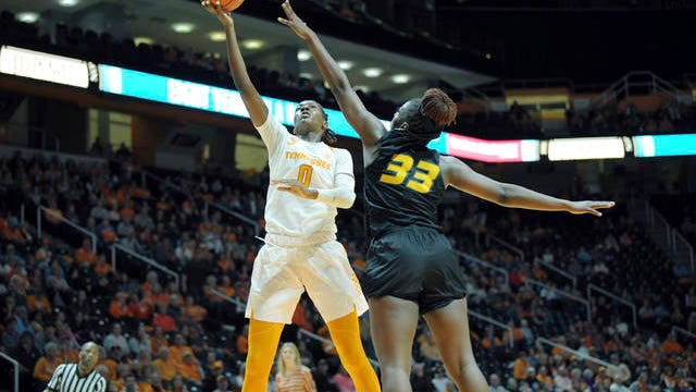 Rennia Davis (0) scored 19 points with 12 rebounds Thursday as 22nd-ranked Tennessee opened Southeastern Conference play with a 77-66 win over visiting Missouri.