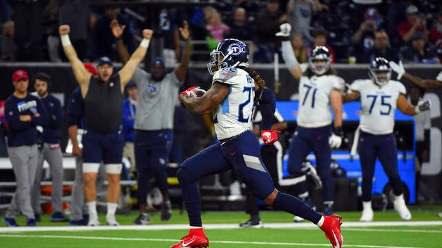 Derrick Henry (22), who sealed the NFL rushing title with this 53-yard touchdown run in Sunday's 35-14 win over the host Houston Texans, will set the tone offensively for the Tennessee Titans as they open postseason play Saturday night at New England.