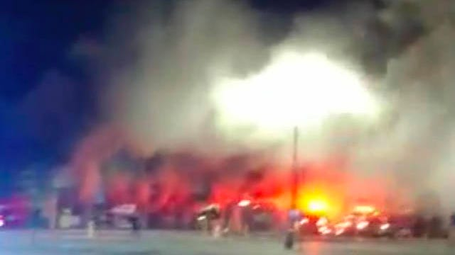Firefighters responded to the Lewisburg Walmart on North Ellington Parkway where flames spread through the store's garden center Monday night.