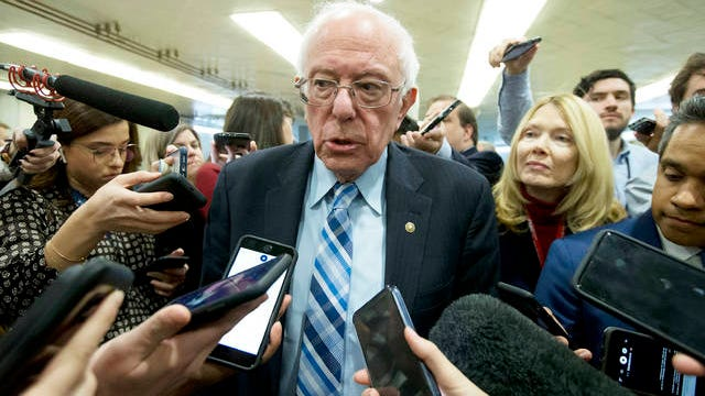 Sen. Bernie Sanders, I-Vt., talks to reporters as he arrives at the Senate for the start of the impeachment trial of President Donald Trump on charges of abuse of power and obstruction of Congress, at the Capitol in Washington on Tuesday.