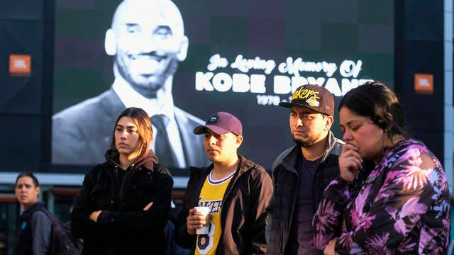 Fans pay their respect at a memorial for Kobe Bryant near Staples Center Monday in Los Angeles. Bryant, the 18-time NBA All-Star who won five championships and became one of the greatest basketball players of his generation during a 20-year career with the Los Angeles Lakers, died in a helicopter crash Sunday.