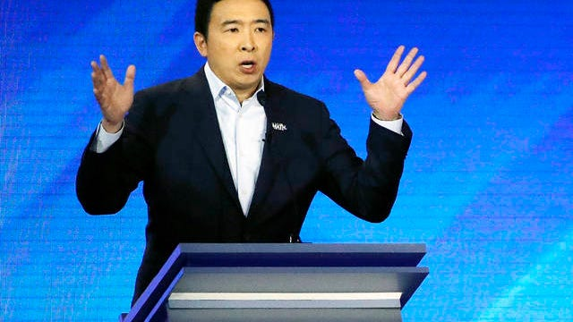 In this Feb. 7 photo, Democratic presidential candidate entrepreneur Andrew Yang speaks during a Democratic presidential primary debate at Saint Anselm College in Manchester, N.H.