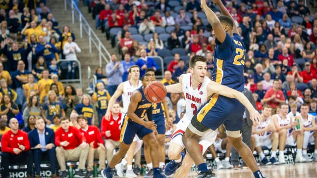 Belmont's Grayson Murphy (2) moves around Murray State's KJ Williams (23) during the second half of an NCAA college basketball game for the championship of the Ohio Valley Conference men's tournament Saturday in Evansville, Ind.