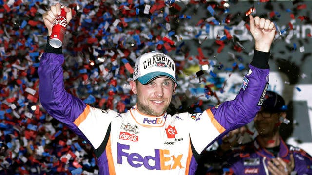 In this Feb. 17 file photo,D enny Hamlin celebrates in Victory Lane after winning the NASCAR Daytona 500 auto race at Daytona International Speedway in Daytona Beach, Fla. NASCAR eased off the brake in the real sports world brought to a sudden halt by the coronavirus and introduced the country to iRacing with some of the sports biggest stars. Hamlin, the three-time Daytona 500 winner, beat Dale Earnhardt Jr. off the final corner Sunday at virtual Homestead-Miami Speedway to win the bizarre spectacle.